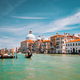Venice, Italy. Tourist gondola trip on Grand Canal. Basilica Santa Maria della Salute against blue - PhotoDune Item for Sale
