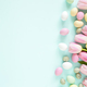 Easter Colorful Candy Eggs and Pink Tulips on Turquoise Background. - PhotoDune Item for Sale