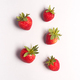 Overhead View Of Individual Fresh Strawberries On White Background - PhotoDune Item for Sale
