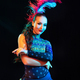 Beautiful young woman in carnival and masquerade costume in colorful neon lights on black background - PhotoDune Item for Sale