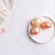 Easter table setting from above. Elegant empty plate, cutlery, napkin and golden eggs on stone - PhotoDune Item for Sale
