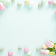 Easter Frame Made of Easter Candy Eggs and Tulips on Turquoise Background. - PhotoDune Item for Sale