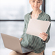 Businesswoman Holding Laptop And Documents Sitting On Office Table - PhotoDune Item for Sale