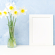 Bouquet of fresh flowers, white frame on table, opposite blue textured concrete wall - PhotoDune Item for Sale