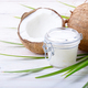 Coconut oil in airtight glass jar and shell pieces on white wooden table - PhotoDune Item for Sale