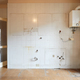 Old, empty kitchen wall with white, dirty tiles in apartment interior - PhotoDune Item for Sale