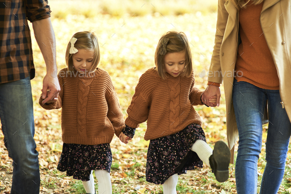 Parents with children walking in autumn woods - Stock Photo - Images
