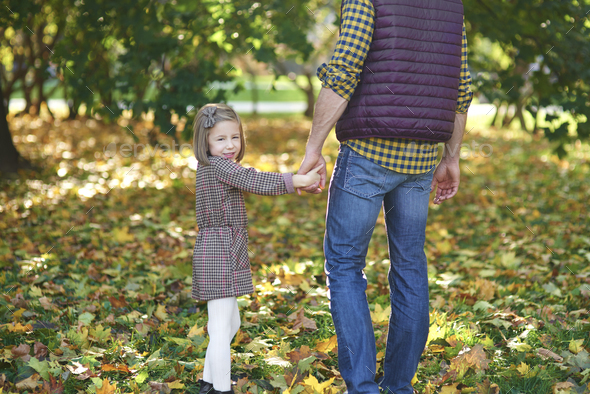 Rear view of father and daughter during autumn walk - Stock Photo - Images