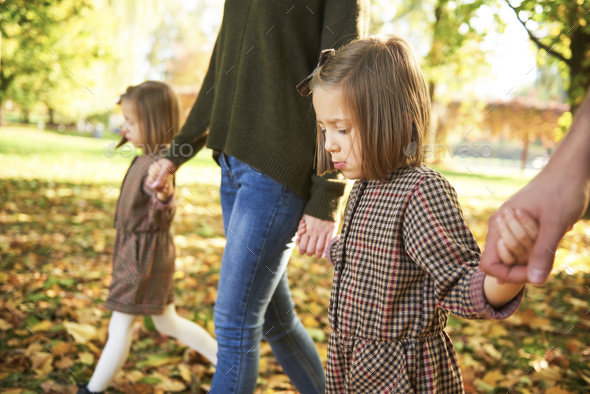 Close up of children holding parents hands - Stock Photo - Images