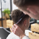 Young man has cutting hair at the hairdresser - PhotoDune Item for Sale