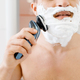 Man shaves his foamed beard with an electric razor - PhotoDune Item for Sale