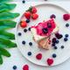 Slice of classic cheesecake with fresh berries on the white plate - healthy organic summer dessert - PhotoDune Item for Sale