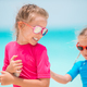 Little happy funny girls have a lot of fun at tropical beach playing together - PhotoDune Item for Sale