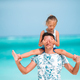 Little girl and happy dad having fun during beach vacation - PhotoDune Item for Sale