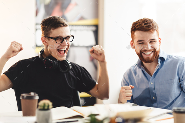 Yeah! Euphoric students clenching fists, expressing happines - Stock Photo - Images