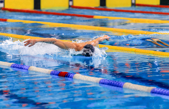 butterfly stroke competition - Stock Photo - Images