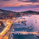 Aerial view of boats and yachts in port and city at night. - PhotoDune Item for Sale