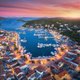Aerial view of boats and yachts in port and city at sunset - PhotoDune Item for Sale