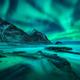 Aurora borealis over snowy mountains, sea coast with sandy beach - PhotoDune Item for Sale