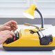 Man typing on yellow typewriter with lamp on white office desk near the window - PhotoDune Item for Sale