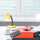 Red typewriter with lamp and coffee on white office desk near the window - PhotoDune Item for Sale
