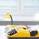 Yellow typewriter with lamp and coffee on white office desk near the window - PhotoDune Item for Sale
