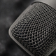 Gray studio condenser microphone on black soft foam of protective case. Macro shot - PhotoDune Item for Sale