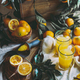 Orange harvest concept. Table with orange juice and box of oranges and orange tree leaves. - PhotoDune Item for Sale