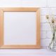 Wooden square frame mockup with grass in the glass jug - PhotoDune Item for Sale