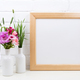 Wooden square frame mockup with pink godetia flowers - PhotoDune Item for Sale