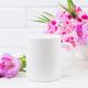 White coffee mug mockup with pink godetia flowers - PhotoDune Item for Sale