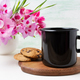 Black campfire enamel mug mockup with pink clarkia flowers - PhotoDune Item for Sale