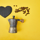 Flat lay of Coffee maker and coffee beans on yellow background. - PhotoDune Item for Sale