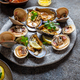 Clams amd mussels shell raw fresh seafood on gray plate with lemon. - PhotoDune Item for Sale