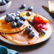 Close up of pancakes with grilled peaches, fresh blueberry and maple syrup. - PhotoDune Item for Sale