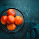 Blood oranges in a plate on a dark blue background. Top view. - PhotoDune Item for Sale
