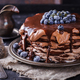Chocolate cake from chocolate pancakes with icing, with blueberries. - PhotoDune Item for Sale