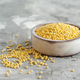 Raw dry hulled millet in a ceramic bowl - PhotoDune Item for Sale