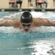 Young man swimming the butterfly in a competition - PhotoDune Item for Sale