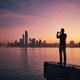 Man with mobile phone at sunrise - PhotoDune Item for Sale