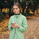 Beautiful sporty girl in earphones with cellphone resting after run in autumn park - PhotoDune Item for Sale