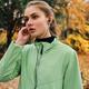 Portrait of sporty girl listening music in earphones running in park - PhotoDune Item for Sale