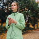 Beautiful sporty girl listening music in earphones on cellphone during run in park - PhotoDune Item for Sale