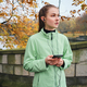 Beautiful sporty girl in earphones with cellphone running with music in autumn park - PhotoDune Item for Sale