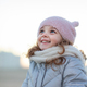 Adorable little girl smiles and looks at the sky. - PhotoDune Item for Sale