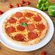 Tasty salami pizza on wooden table - PhotoDune Item for Sale