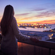 Young woman contemplating the sea from a balcony - PhotoDune Item for Sale
