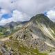 Mountain stone range peak against blue cloudy sky - PhotoDune Item for Sale