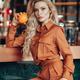 Nice fashion model holding fruit in cafe - PhotoDune Item for Sale