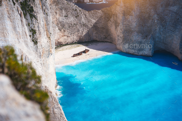 Navagio beach with turquoise blue sea water surrounded by huge white cliffs. Famous landmark - Stock Photo - Images